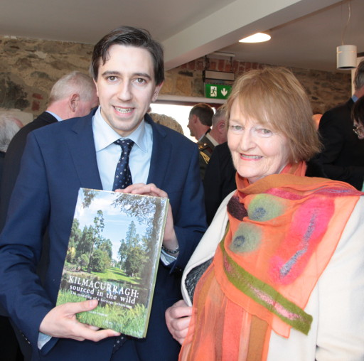 Megan O'Beirne presents her book to Minister Harris
